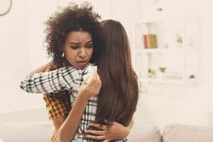 woman-hugging-friend-with-anxiety 3
